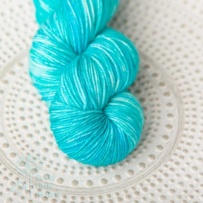 Waving blue. Handdyed hank of DK weight superwash merino wool. Indie dyer