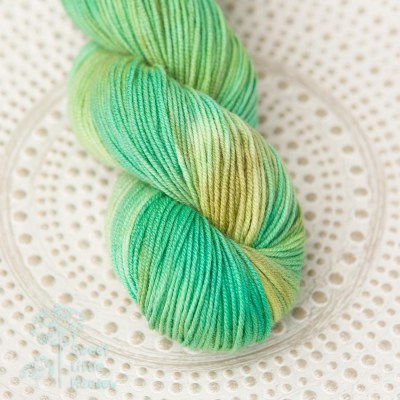 Fresh green moss. Handdyed hank of DK weight superwash merino wool. Indie dyer