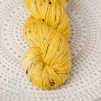 Hand dyed Ocher yellow on sock sport weight merino superwash with donegal nep