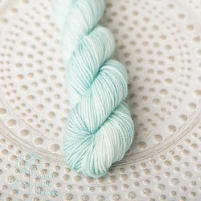 Mint green pastel on a handdyed mini skein sock sport superwash merino wool indie dyer